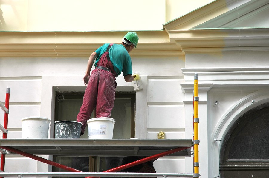 Strata contractor painting a building